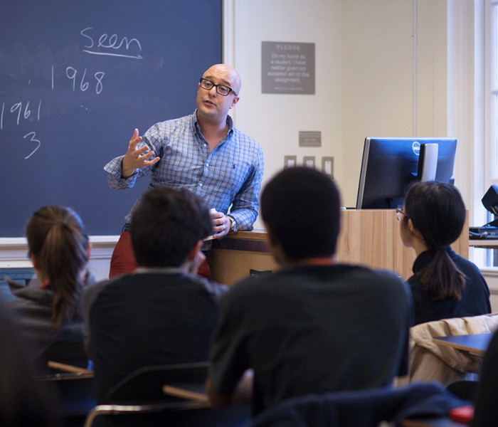 Professor Andre Cavalcante with student discussion